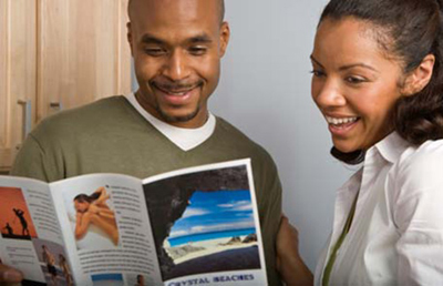 two people take a look at a brochure printing